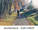 Elderly Man Walking With A...