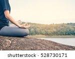 women yoga in nature near river ...   Shutterstock . vector #528730171