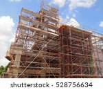 JOHOR, MALAYSIA -OCTOBER 05, 2016: Scaffolding used as the temporary structure to support platform, form work and structure at the construction site. Also used it as a walking platform for workers.   - stock photo