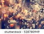 chrystal chandelier close up.... | Shutterstock . vector #528780949