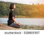 asian woman practicing yoga... | Shutterstock . vector #528805507