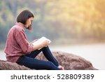 beautiful woman reading a book...   Shutterstock . vector #528809389