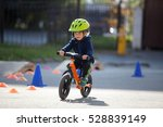 Child In Helmet Ride Balance...