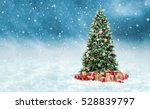 Stock photo beautiful christmas tree with golden and red present boxes in a snowy winter landscape 528839797