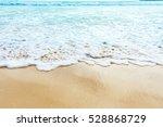 wave of blue sea on sandy beach.... | Shutterstock . vector #528868729