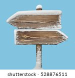 wooden direction sign with snow ... | Shutterstock . vector #528876511