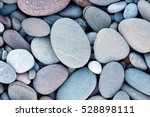 Abstract smooth round pebbles sea texture background