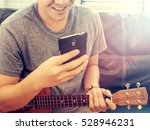 a man using a phone while play... | Shutterstock . vector #528946231