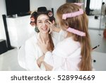 cute little girl doing makeup... | Shutterstock . vector #528994669
