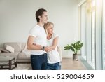 young happy couple  holding a... | Shutterstock . vector #529004659