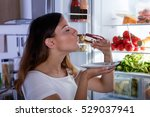 woman eating cake | Shutterstock . vector #529037941