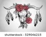 Stock vector bull skull with roses on her head and with feathers hanging from the horns graphic illustration 529046215