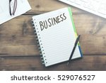 business word on notepad and ... | Shutterstock . vector #529076527