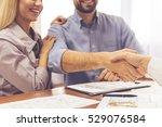couple visiting a realtor. men... | Shutterstock . vector #529076584