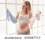 Beautiful Pregnant Woman Is...