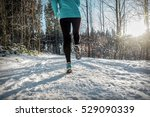 woman running at snowly winter... | Shutterstock . vector #529090339