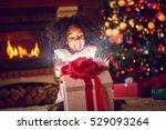 surprise girl opening christmas ... | Shutterstock . vector #529093264