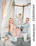 happy young parents with baby... | Shutterstock . vector #529099444