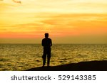 silhouettes of fisherman on the ... | Shutterstock . vector #529143385