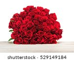 Stock photo colorful flower bouquet from red roses isolated on wooden background closeup 529149184