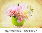Still life of a beautiful floral arrangement  in a vase. - stock photo