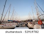 Sailing boats in turkish marine at sunset - stock photo