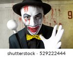 scary evil clown wearing a... | Shutterstock . vector #529222444
