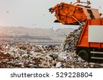 Garbage Truck Dumping The...
