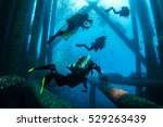 four dive crew on the oil rig  | Shutterstock . vector #529263439