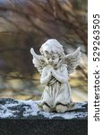 Angel Statue On Gravestone In...