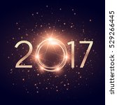 glowing 2017 text with glitter... | Shutterstock .eps vector #529266445
