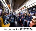Small photo of NEW YORK, USA - October 17, 2016. Inside New York City Subway Wagon with Other People in Background