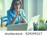young woman sitting at office... | Shutterstock . vector #529299217