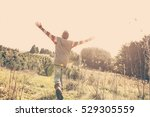 boy running and raising his... | Shutterstock . vector #529305559