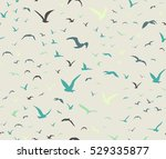 Stock vector blue colored seagulls silhouettes as seamless pattern 529335877