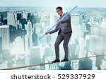 businessman doing tightrope... | Shutterstock . vector #529337929