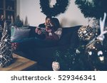 young couple enjoying christmas ... | Shutterstock . vector #529346341