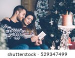 young couple sitting together... | Shutterstock . vector #529347499
