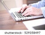 male hands typing on laptop...   Shutterstock . vector #529358497