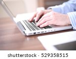 male hands typing on laptop...   Shutterstock . vector #529358515