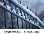 Metal Fence In The Snow