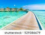 beautiful water villas in... | Shutterstock . vector #529386679