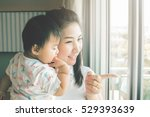 happy mother holding adorable... | Shutterstock . vector #529393639