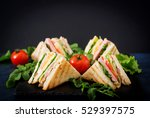 club sandwich with ham  bacon ... | Shutterstock . vector #529397575