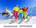 skiing family enjoying winter... | Shutterstock . vector #529410829