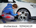 man worker washing car's alloy... | Shutterstock . vector #529424119