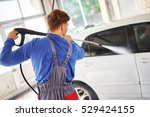 man worker washing car on a car ... | Shutterstock . vector #529424155