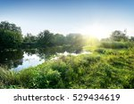 Sun Over The River In The...