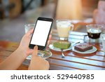 smart phone in hand with coffee ... | Shutterstock . vector #529440985