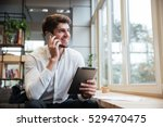 smiling businessman dressed in... | Shutterstock . vector #529470475